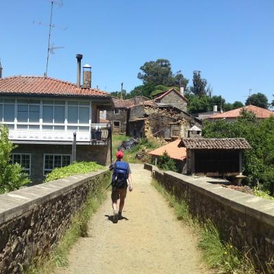 Man walking over bridge in Galicia, Spain